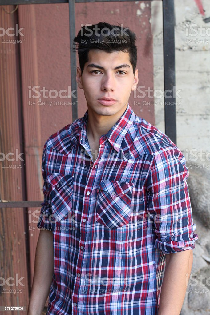 Handsome young man outdoors in downtown stock photo