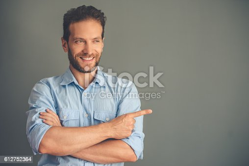 612752180istockphoto Handsome young man 612752364