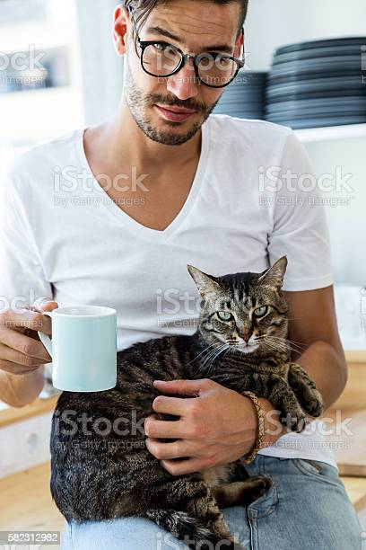 Handsome young man playing with cat in the kitchen picture id582312982?b=1&k=6&m=582312982&s=612x612&h=f3dijjg9d3mfyf cxgnm  yvbmudqtrfnyg7zogg1fw=