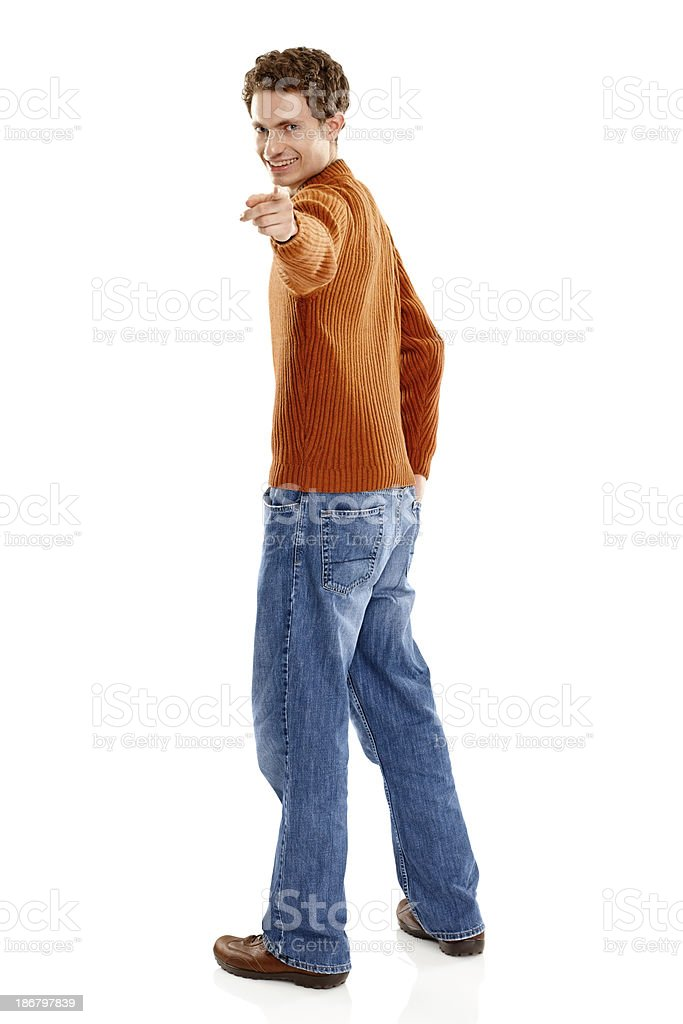 Handsome young man pointing at you stock photo
