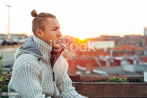 521022435istockphoto handsome young man portrait in front of skyline 521006593