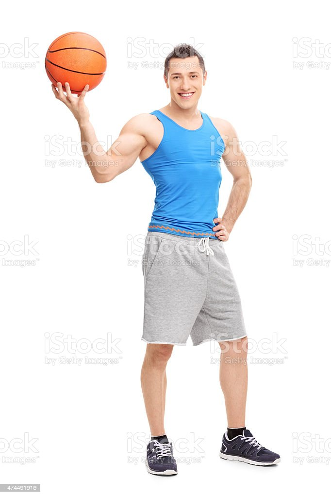 Full length portrait of a handsome young man posing with a basketball...