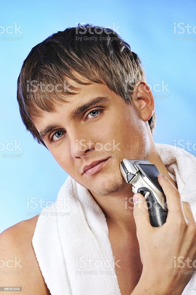 Handsome young man shaving royalty-free stock photo