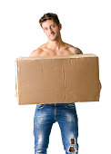 istock Handsome young man shirtless holding big cardboard box 450378397