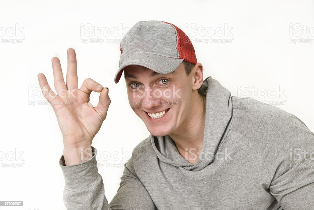 handsome young man shows a sign OK royalty-free stock photo