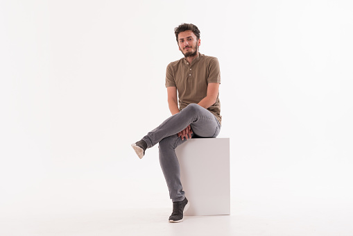 Handsome young man smiling against white background