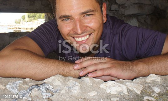 istock Handsome young man smiling close up 1015437510