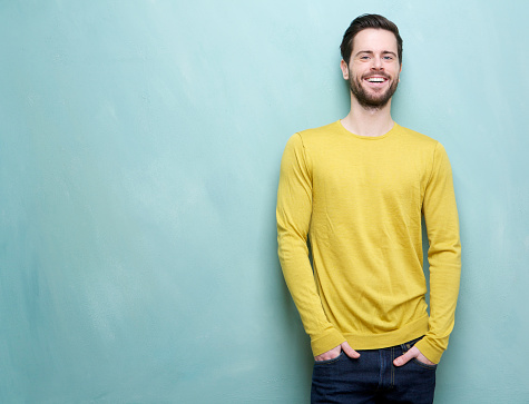 istock Handsome young man smiling leaning on blue background 186222773