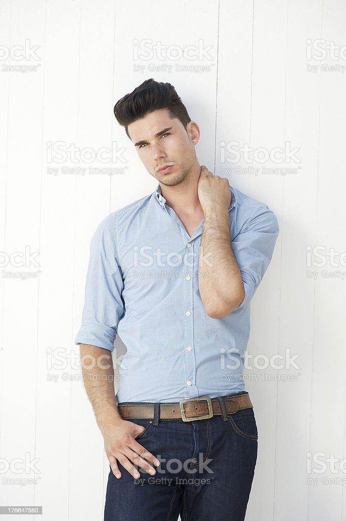 Handsome young man standing against white background royalty-free stock photo