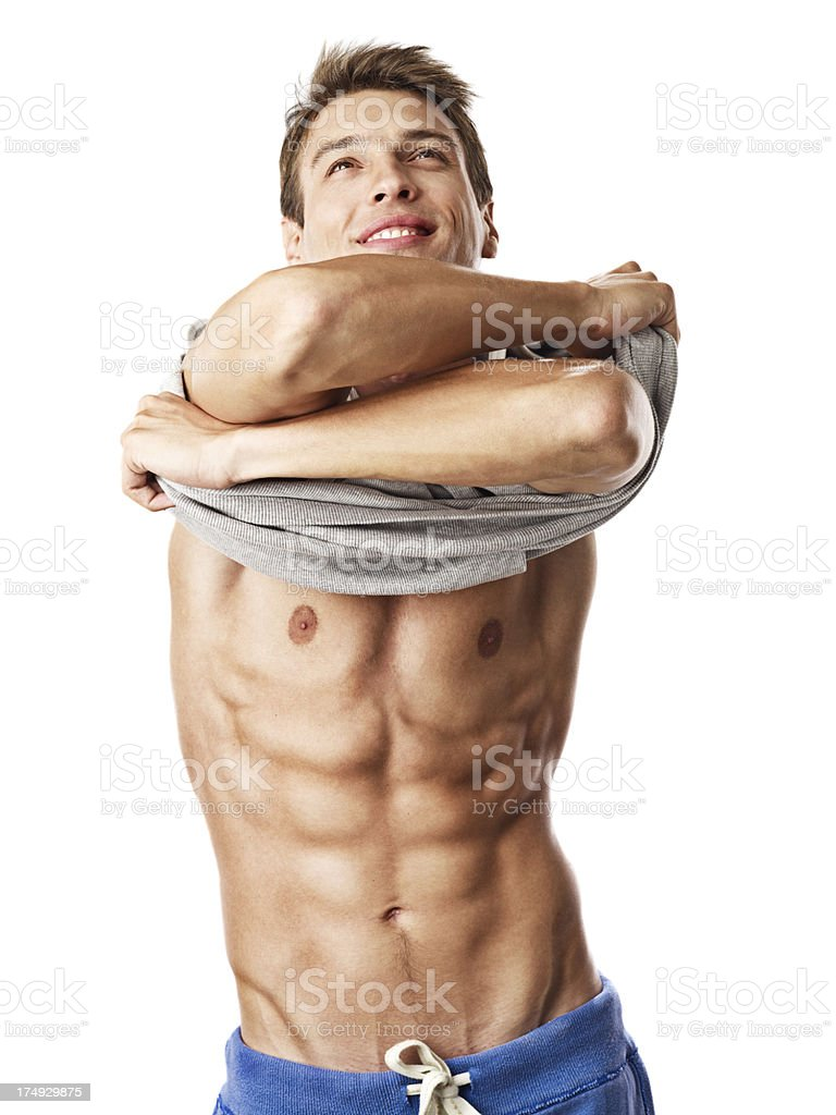 Handsome Young Man Taking Off His Shirt stock photo