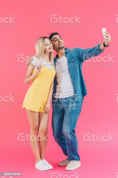 Handsome young man taking selfie with girlfriend doing peace sign on picture id1055216028?b=1&k=6&m=1055216028&s=612x612&h=eobib3lnxshxjwsjr 3gxdc5t5dexypgh8b5n9emheo=