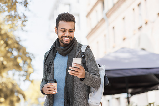 Handsome Young Man Using Smart Phone In A City Stock Photo - Download Image Now