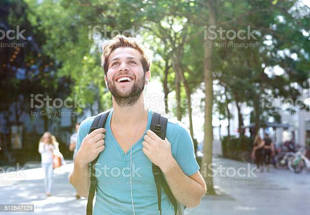 Handsome young man walking outdoors with backpack picture id512547129?b=1&k=6&m=512547129&s=612x612&h=28qgt3wfuzfsetgc6q9alj7vem pvfz6c6pnt1rxa5s=