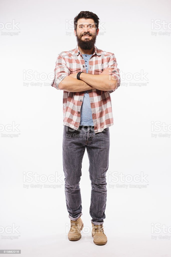 Handsome young man with beard full heigh with crossed hands stock photo