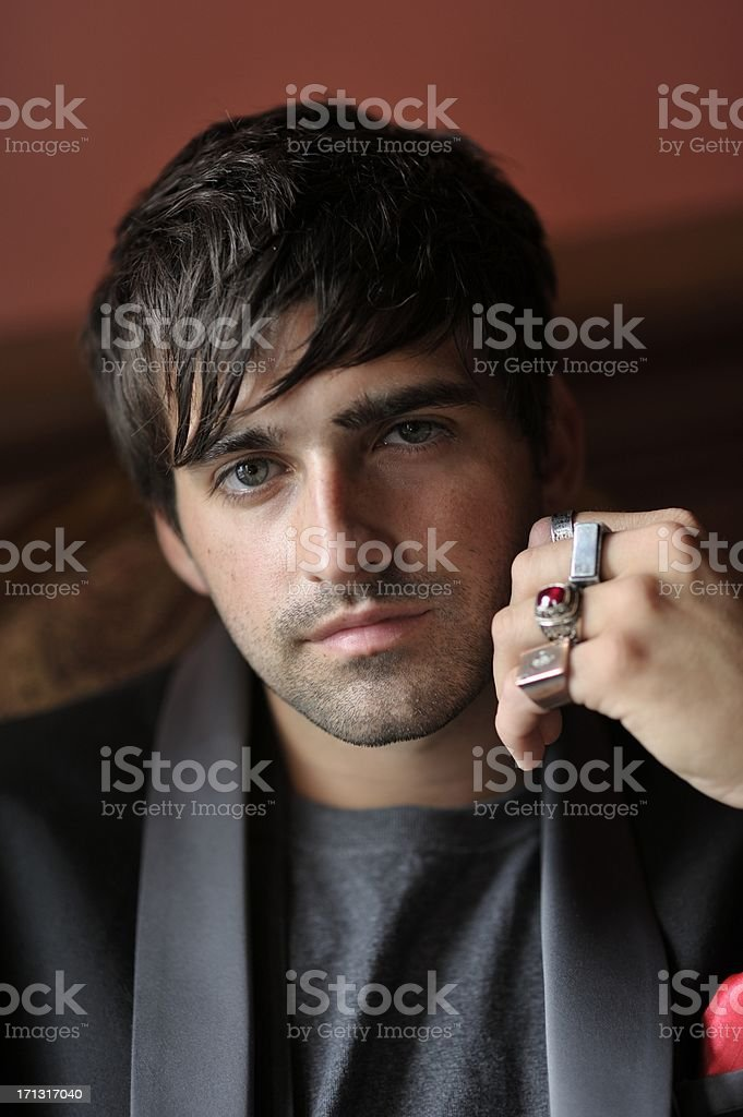 Handsome Young Man with Chunky Jewellery stock photo