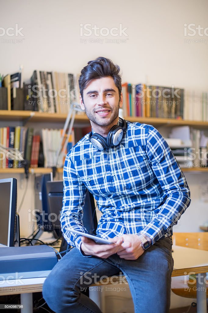 Handsome young man with digital tablet at startup stock photo