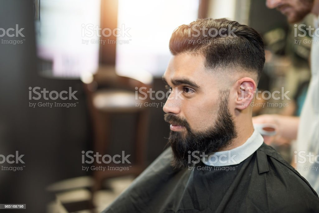 Handsome young man with fresh haircut. royalty-free stock photo