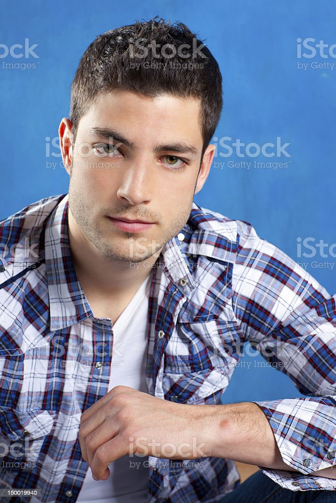 handsome young man with plaid shirt on blue royalty-free stock photo