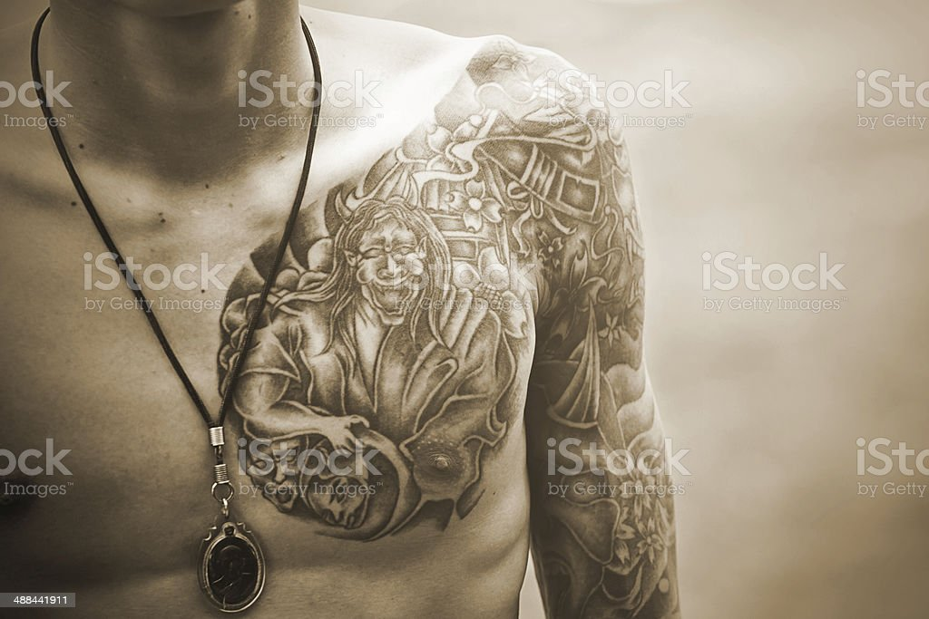Handsome young man with tattoo stock photo