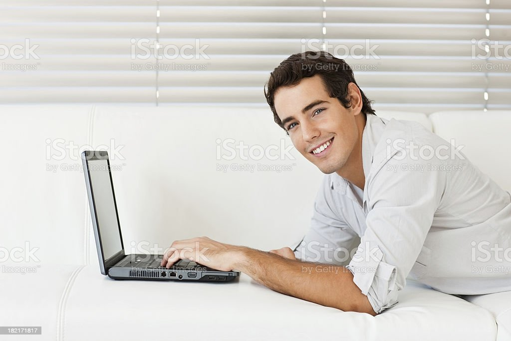 Handsome young man working on laptop royalty-free stock photo
