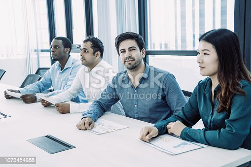 istock Handsome young manager visiting business conference 1073454658
