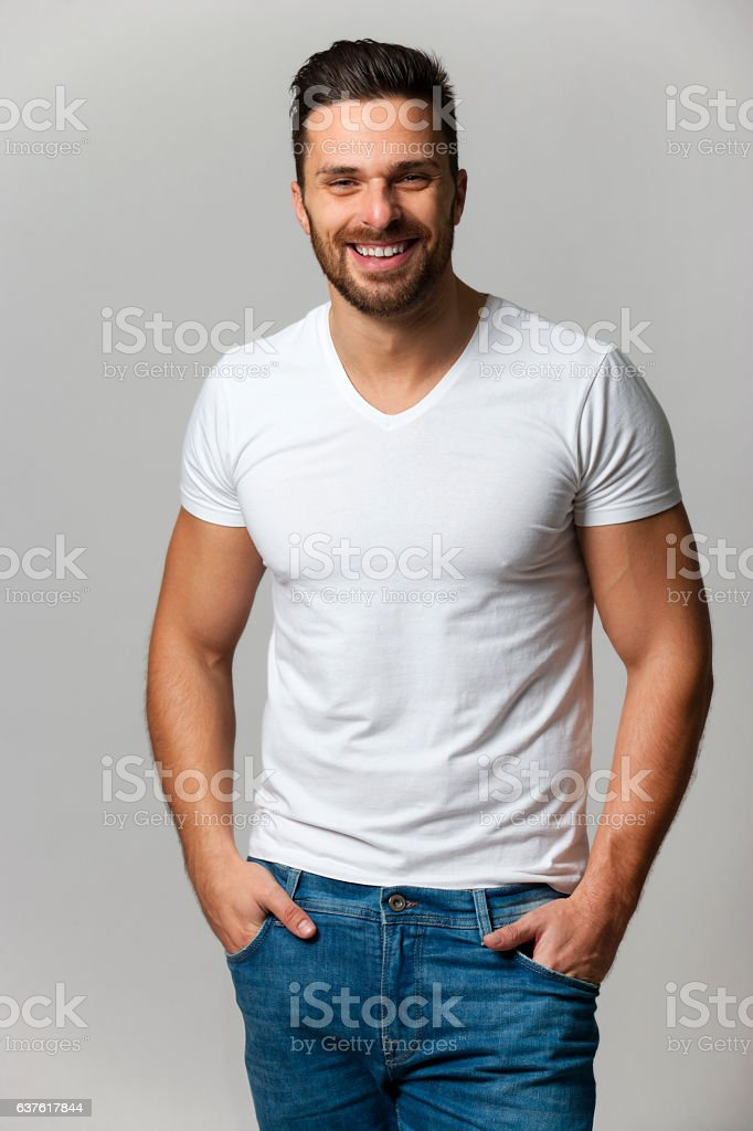 Handsome young man,boy,posing in white t shirt foto