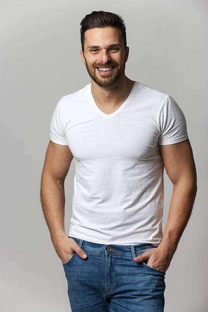 Handsome young man,boy,posing in white t shirt stock photo