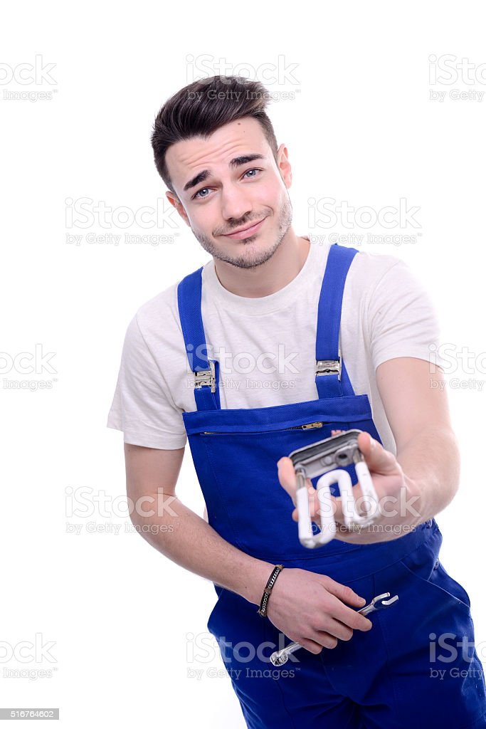handsome young plumber isolated white background holding washing machine heater stock photo