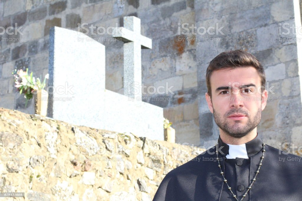 Handsome young priest close up looking seductive stock photo