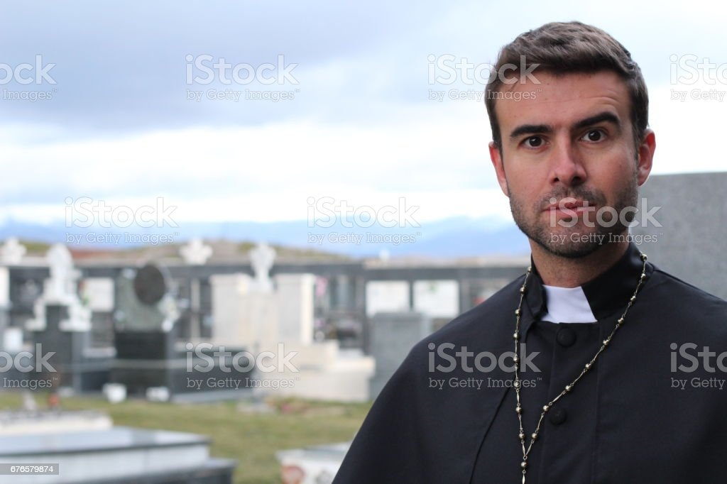 Handsome young priest close up stock photo