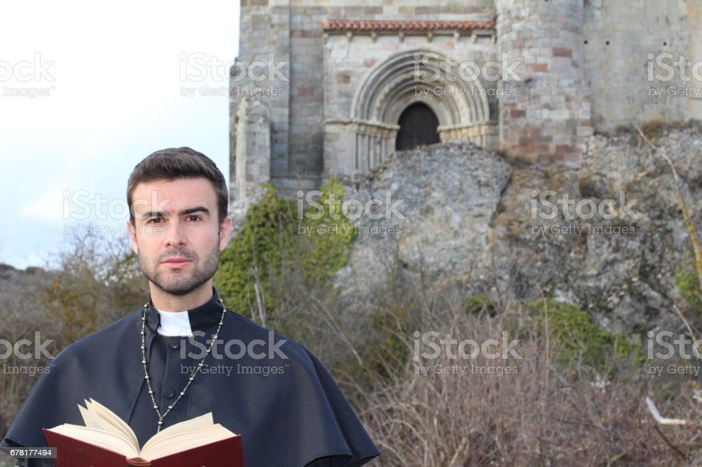 Handsome young priest close up with copy space stock photo