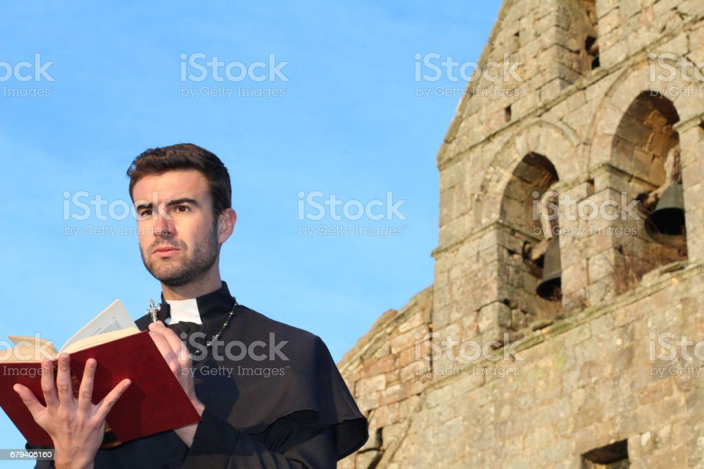 Handsome young priest close up with copyspace stock photo