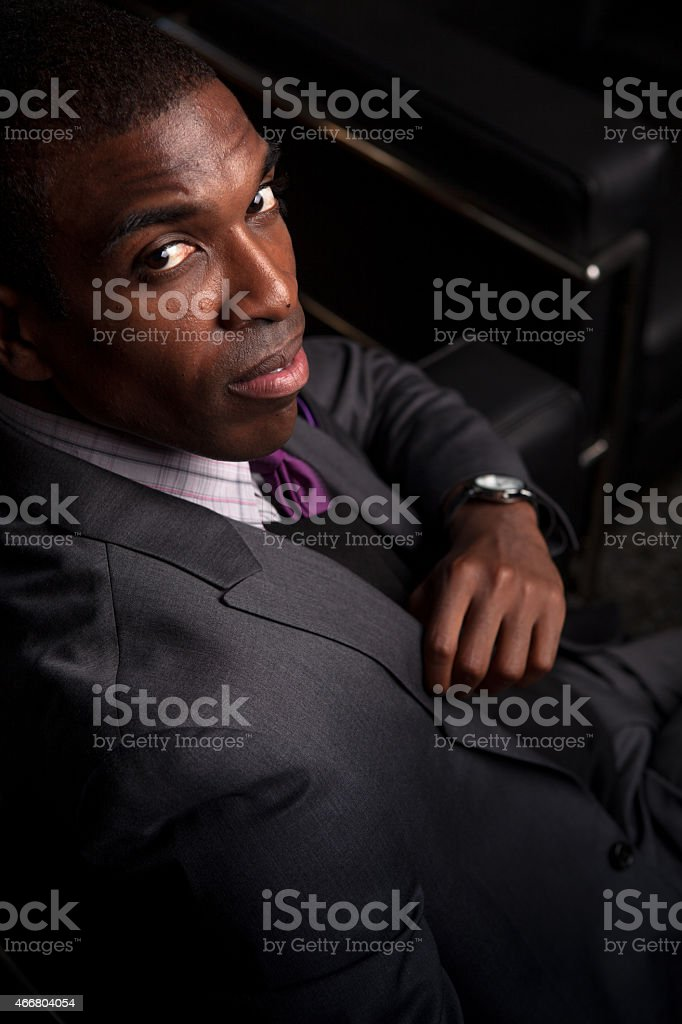 Handsome Young Professional Sitting on Sofa stock photo