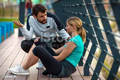 istock Handsome Young Sports Woman Have Physical Injury of Knee During a Practice with his Friend 1199486156