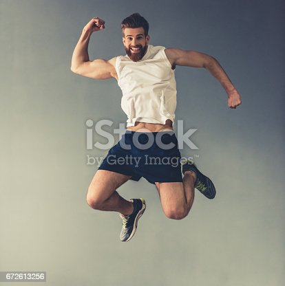 istock Handsome young sportsman 672613256