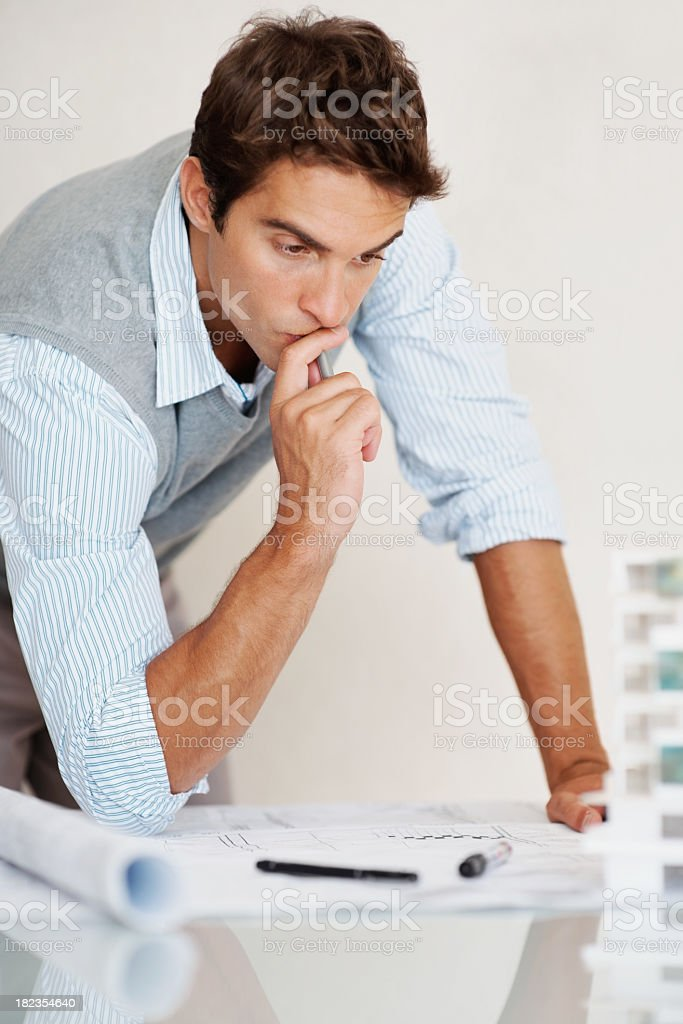 Handsome young thoughtful architect at work royalty-free stock photo