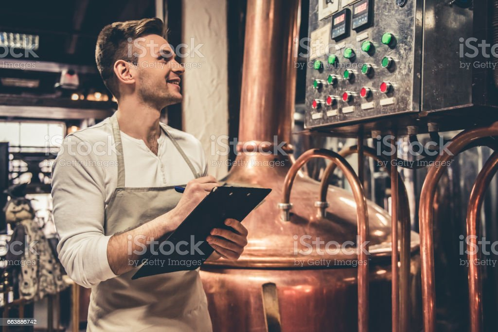 Handsome young waiter stock photo
