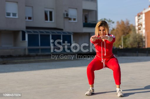 Handsome young woman exercise in the city