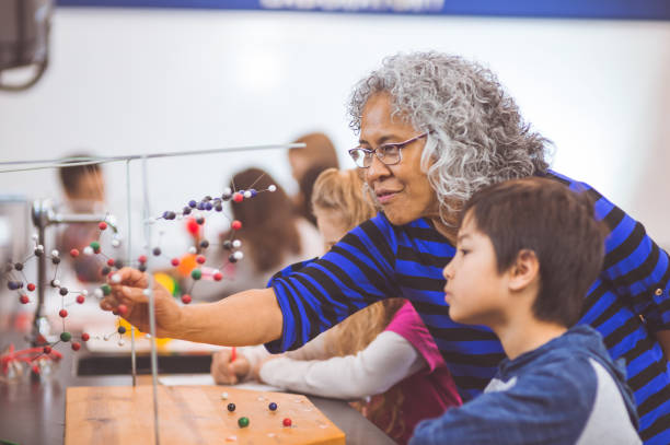 hands-on science lab - hawaiian ethnicity stock photos and pictures