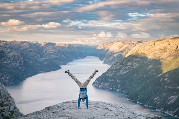 Handstand, Pulpit Rock Preikestolen, Norway stock photo