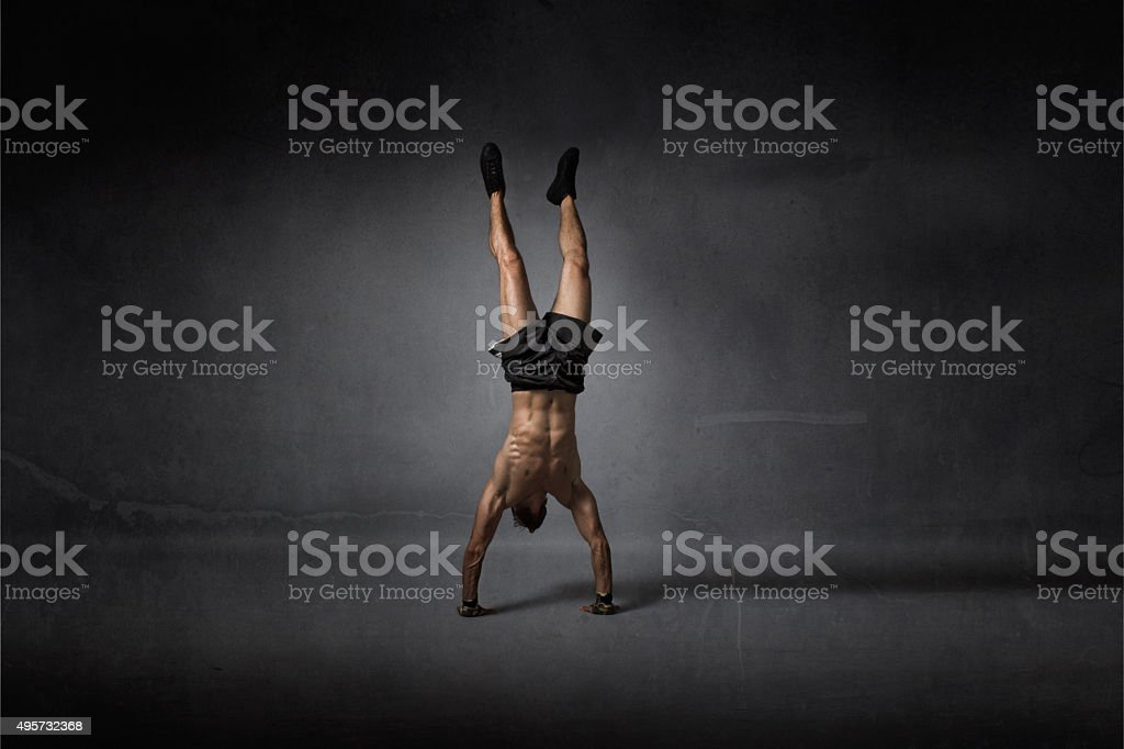 handstanding for athletic man stock photo