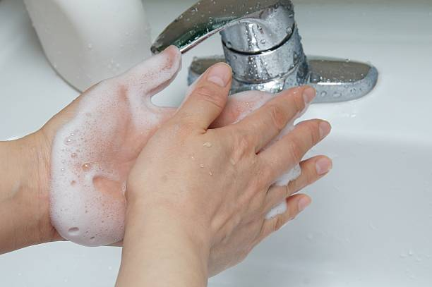 hand-washing with soap - handwashing stock photos and pictures