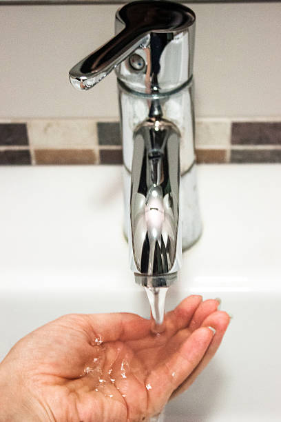 handwashing, woman hand under the faucet - handwashing stock photos and pictures