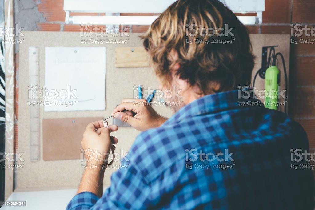 Handworker making glasses rim royalty-free stock photo