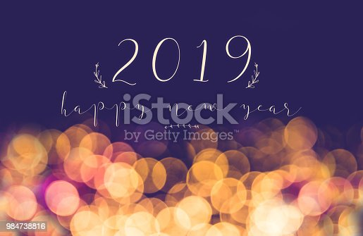 istock handwriting 2019 happy new year on vintage blur festive bokeh light background,holiday greeting card. 984738816
