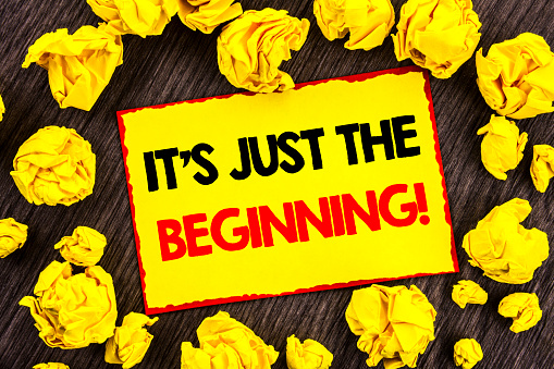 istock Handwriting Announcement text  It Is Just The Beginning. Conceptual photo Goal Success Plan For New Dream Life Career written on Yellow Stikcy Note Folded Paper on the wooden background 947063092
