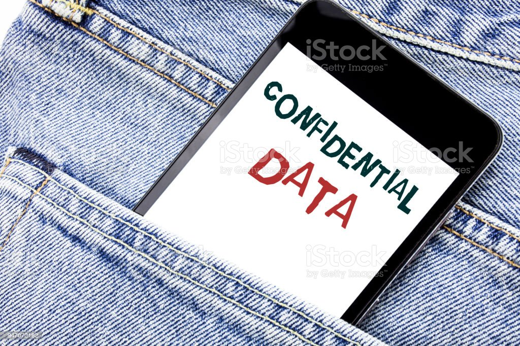 Handwriting Announcement text showing Confidential Data. Business concept for Secret Protection Written phone mobile phone, cellphone placed in the man front jeans pocket. stock photo