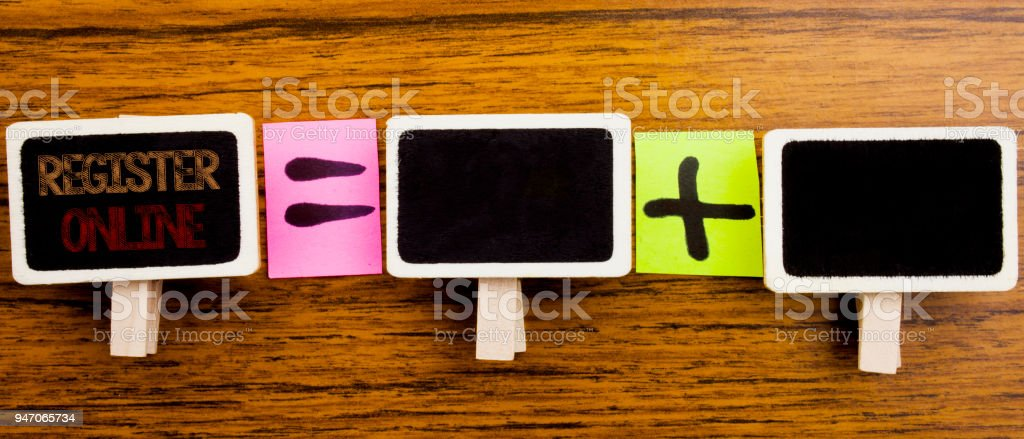 Handwriting Announcement text showing Register Online. Business concept for Internet Subscribe Written on clips, wooden background for equation sign with plus. For your text. stock photo