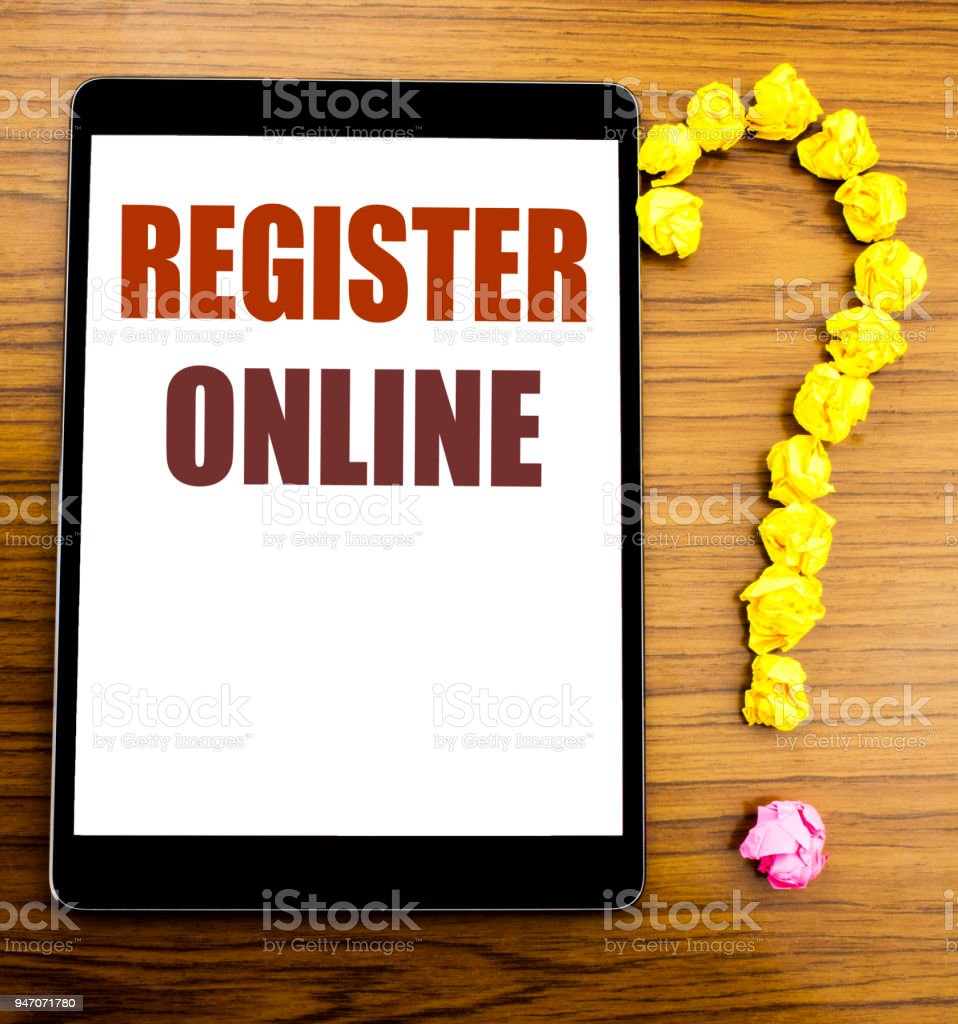 Handwriting Announcement text showing Register Online. Business concept for Internet Subscribe Written on tablet with wooden background in the office table. stock photo