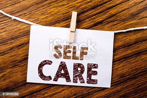 1175869940istockphoto Handwriting Announcement text showing Self Care. Business concept for Taking caring for own Health written on sticky note paper on the wooden background. 918556086